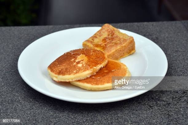 High Angle View Of Pancakes In Plate On Table