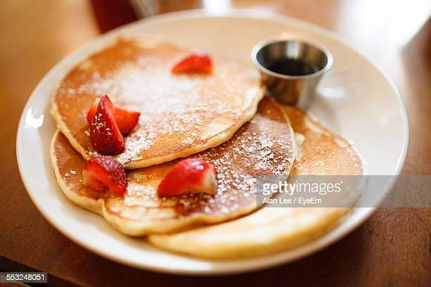High Angle View Of Pancakes Served On Table At Home
