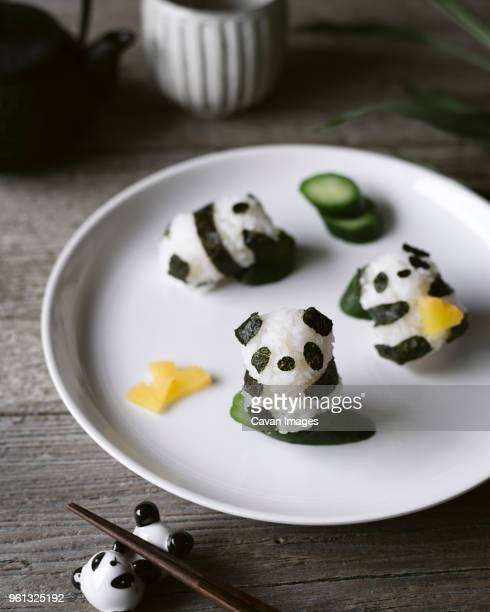 high angle view of panda shaped onigiri on plate - nori stock pictures, royalty-free photos & images