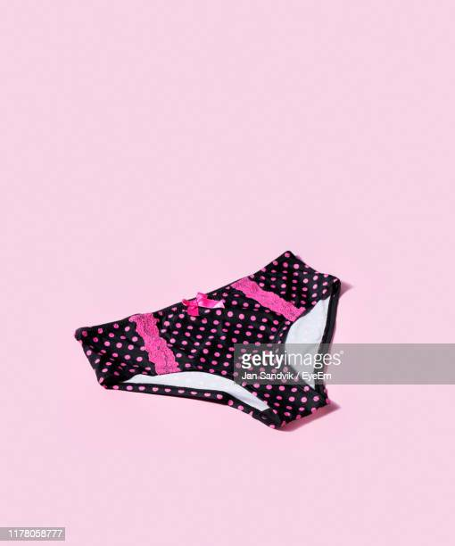 high angle view of panties on pink background - knickers stock pictures, royalty-free photos & images