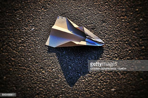 High Angle View Of Paper Airplane On Street