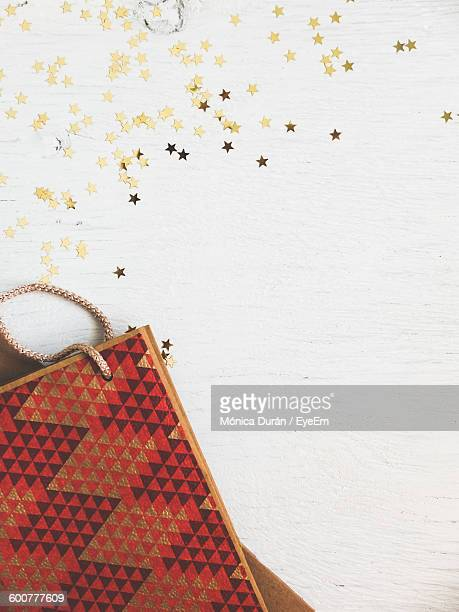 High Angle View Of Paper Bag With Decoration On Table