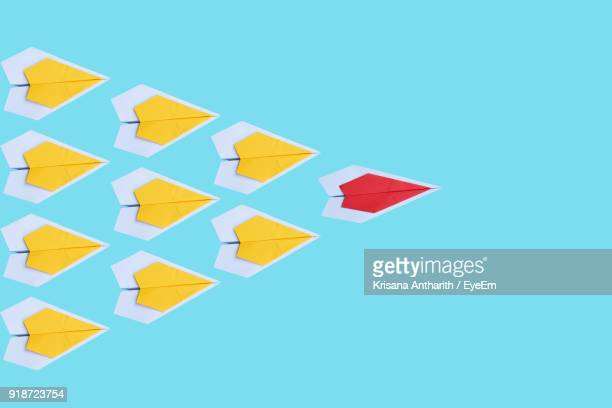 high angle view of paper boats over blue background - origami fotografías e imágenes de stock