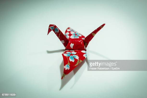 High Angle View Of Paper Crane On Background