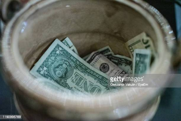 high angle view of paper currency in container - oleksandr vakulin stock pictures, royalty-free photos & images