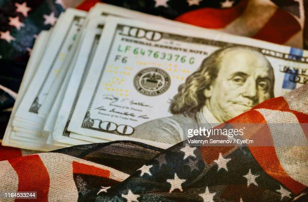 high angle view of paper currency on american flag - money politics stock pictures, royalty-free photos & images