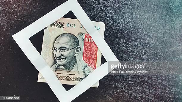 High Angle View Of Paper Currency On Table