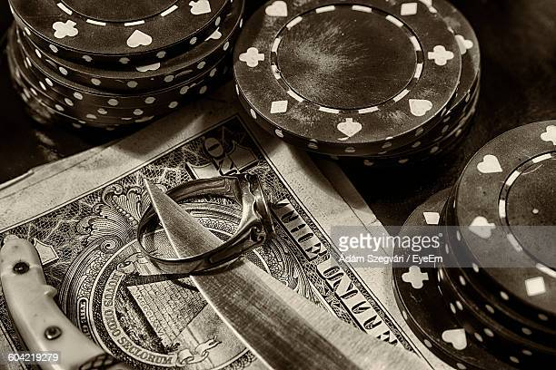 high angle view of paper currency with gambling chips on table - gambling table stock pictures, royalty-free photos & images