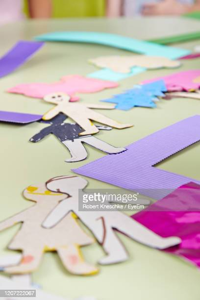 high angle view of paper doll on table - puppet stock pictures, royalty-free photos & images