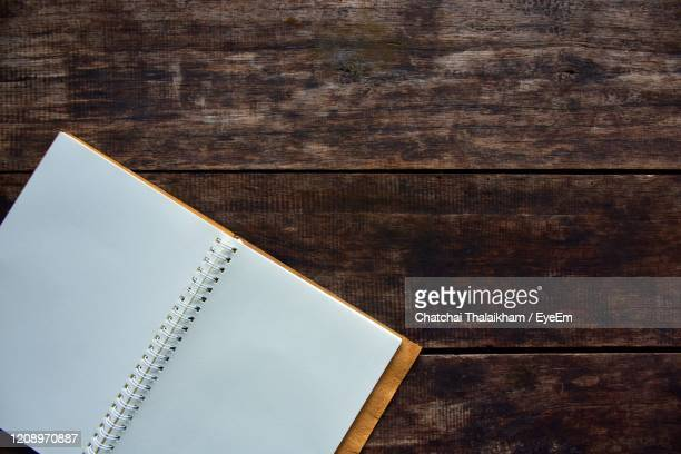 high angle view of paper on table - chatchai thalaikham stock pictures, royalty-free photos & images