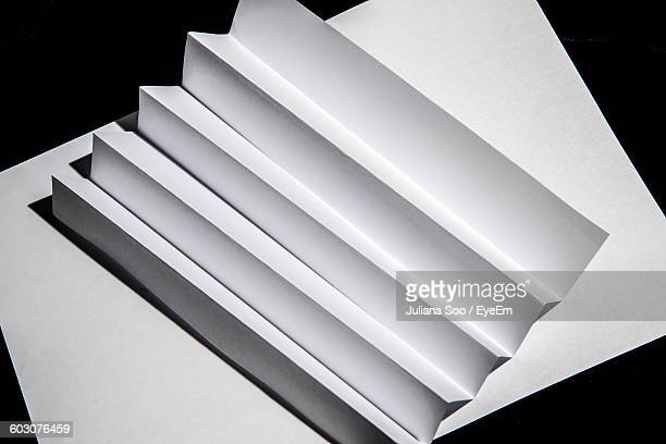 High Angle View Of Papers On Table