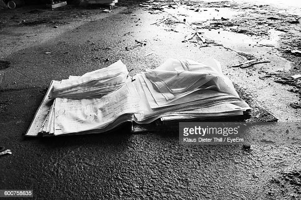 High Angle View Of Papers On Wet Street