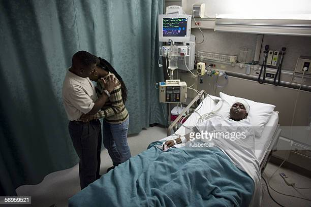High angle view of parents in a hospital with their son