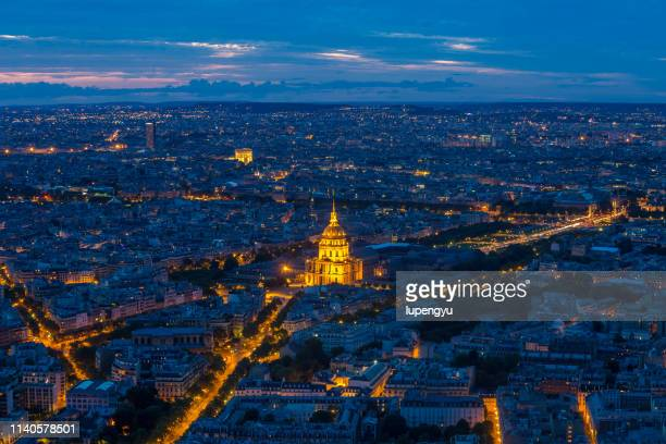 high angle view of paris at dusk - paris night stock pictures, royalty-free photos & images