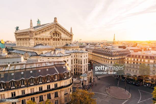 high angle view of paris skyline at sunset - parís fotografías e imágenes de stock