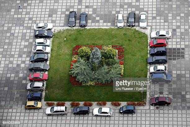 High Angle View Of Park Amidst Cars In Parking Lot