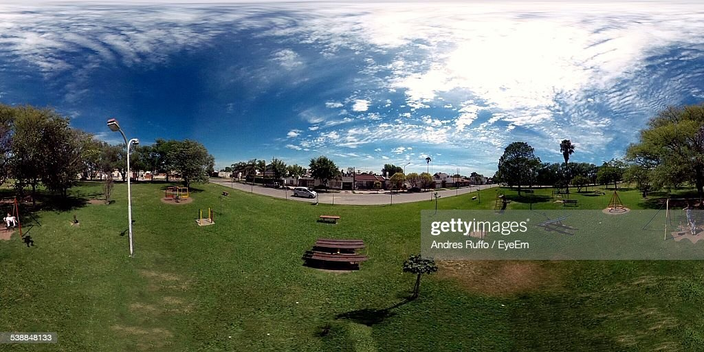 High Angle View Of Park In City Against Cloudy Sky : Stock Photo