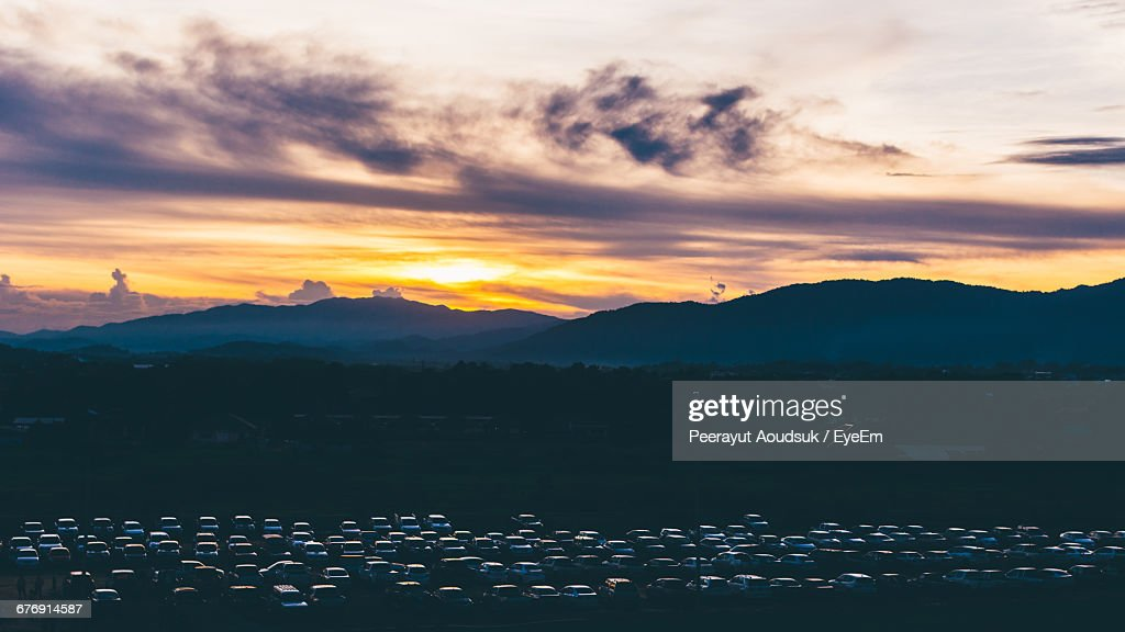 High Angle View Of Parked Cars Against Mountains During Sunset : Foto de stock