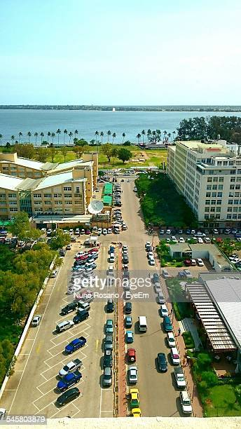 High Angle View Of Parking Lot By Street In City Against Clear Sky
