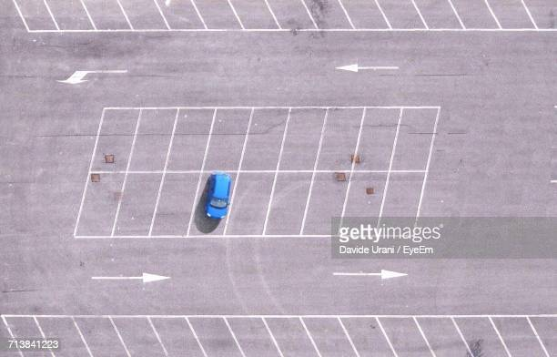 high angle view of parking lot - car park stock pictures, royalty-free photos & images