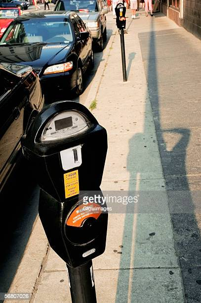 High angle view of parking meters on a sidewalk, Chicago, Illinois, USA