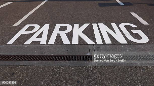 High Angle View Of Parking Sign On Street