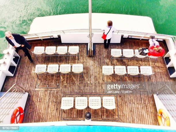 High Angle View Of Passengers On Ship Sailing In Sea