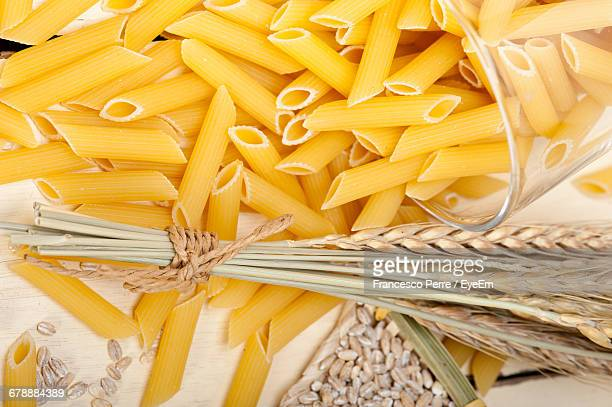 High Angle View Of Pasta And Wheat Plant On Table