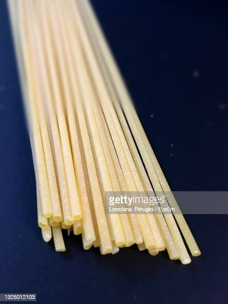 high angle view of pasta on table against black background - loredana perugini stock pictures, royalty-free photos & images