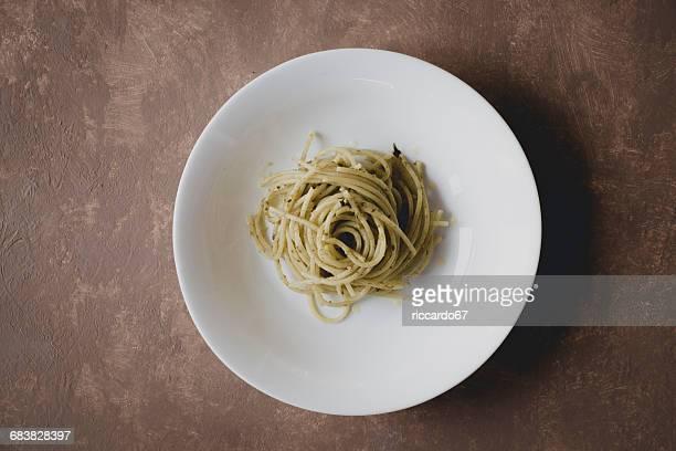 high angle view of pasta served in white plate - piatto stoviglie foto e immagini stock