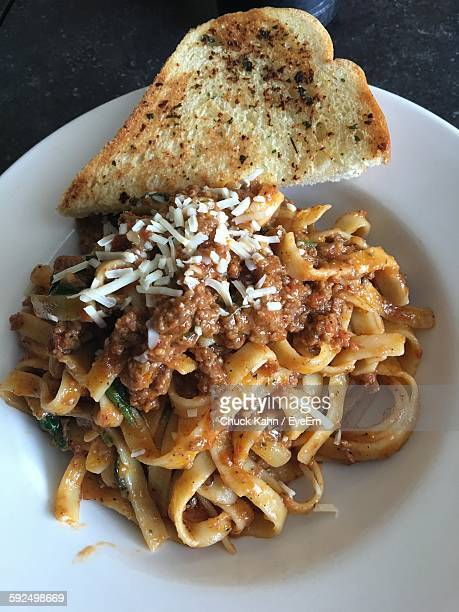 High Angle View Of Pasta With Bread Served On Plate