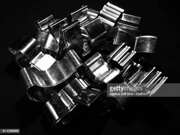 High Angle View Of Pastry Cutters On Black Background
