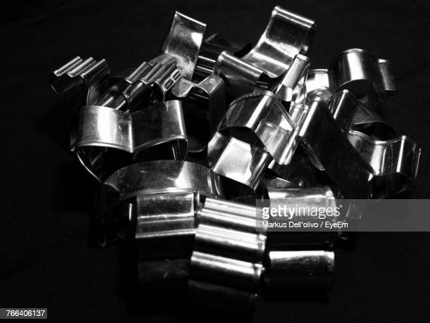 High Angle View Of Pastry Cutters Over Black Background
