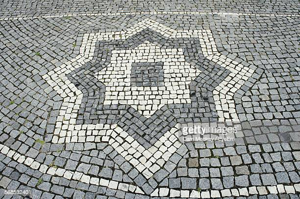 High Angle View Of Patterned Cobblestone Street