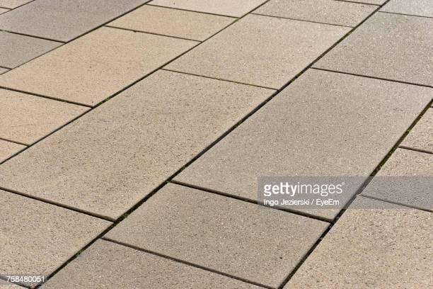 high angle view of paved footpath - paving stone stock pictures, royalty-free photos & images