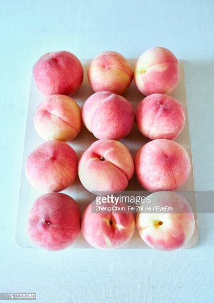 high angle view of peaches in tray - モモ ストックフォトと画像