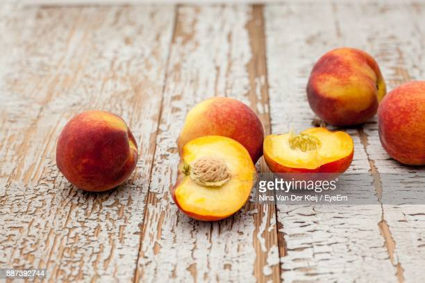 High Angle View Of Peaches On Wooden Table