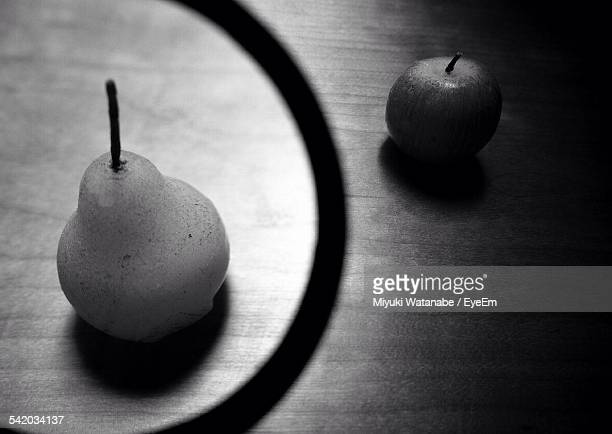 High Angle View Of Pear And Apple On Table