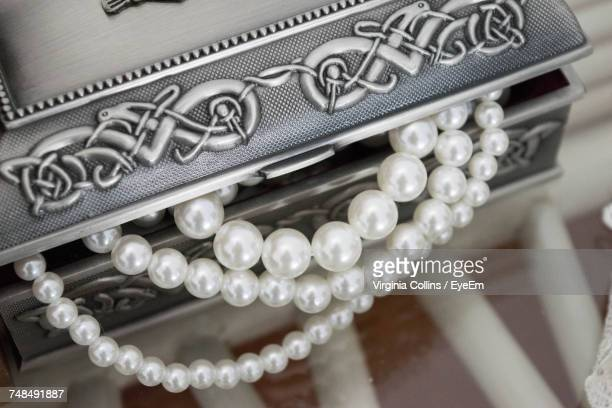 High Angle View Of Pearl Necklaces In Jewelry Box On Table
