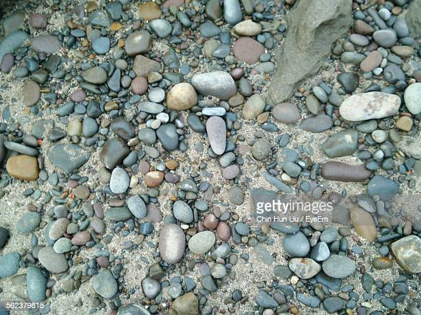 high angle view of pebbles on field - liu he stock pictures, royalty-free photos & images