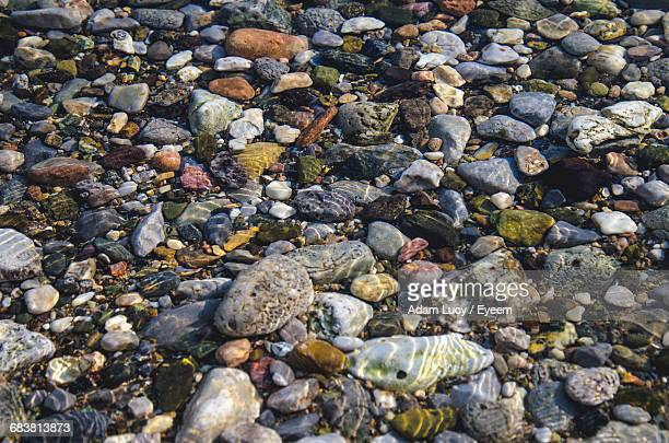 High Angle View Of Pebbles Underwater