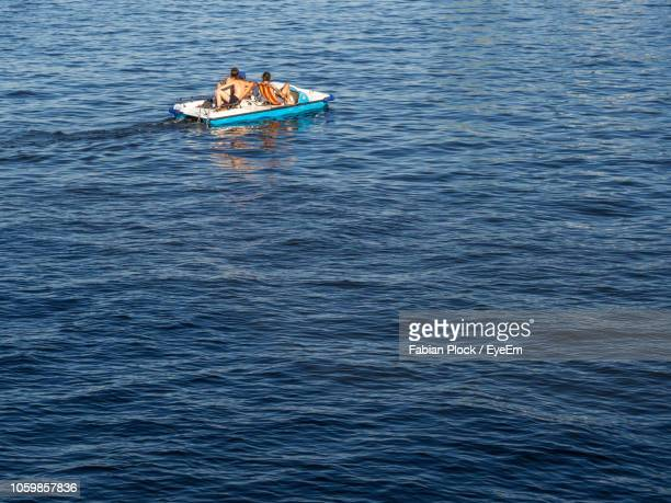 high angle view of pedal boat on river spree, berlin - pedal boat stock pictures, royalty-free photos & images