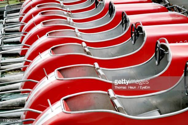 high angle view of pedal boats moored on lake - pedal boat stock pictures, royalty-free photos & images