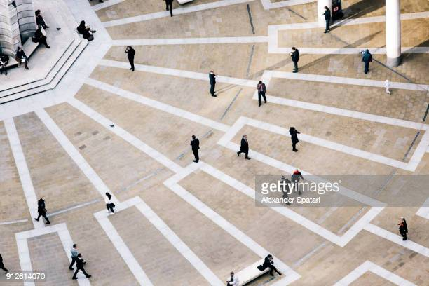 high angle view of pedestrians at paternoster square, london, uk - aerial view stock-fotos und bilder