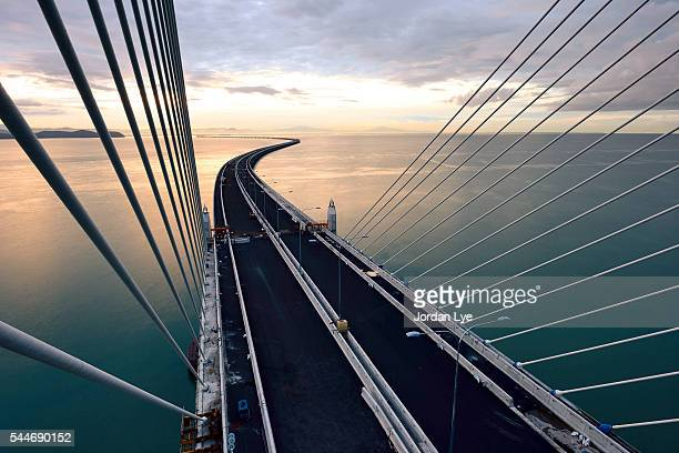 high angle view of penang second bridge - brücke stock-fotos und bilder