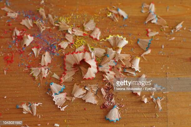 High Angle View Of Pencil Shavings On Wooden Table