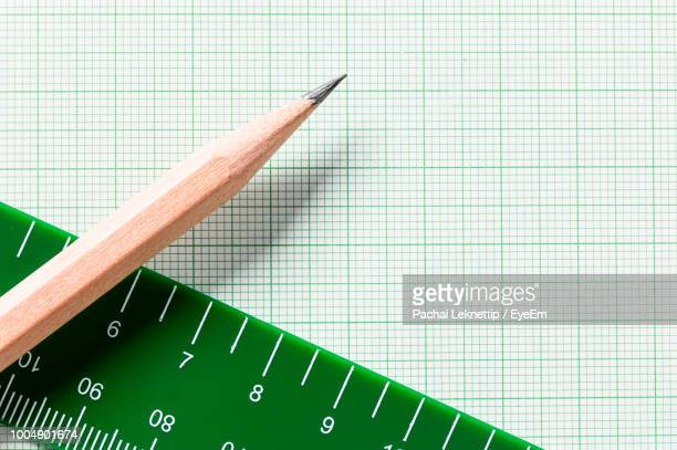 high angle view of pencil with graph paper and ruler - ruler stock photos and pictures