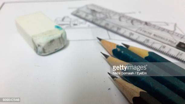 High Angle View Of Pencils And Eraser With Ruler On Paper
