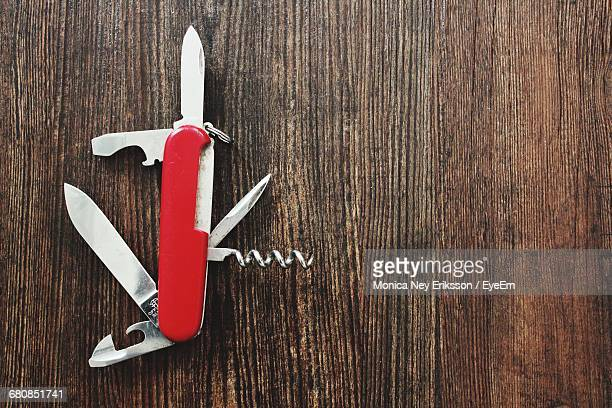 High Angle View Of Penknife On Wooden Table