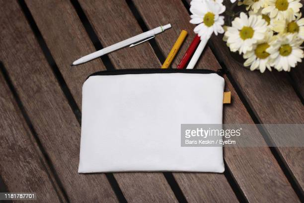 high angle view of pens with flowers on table - pencil case stock pictures, royalty-free photos & images
